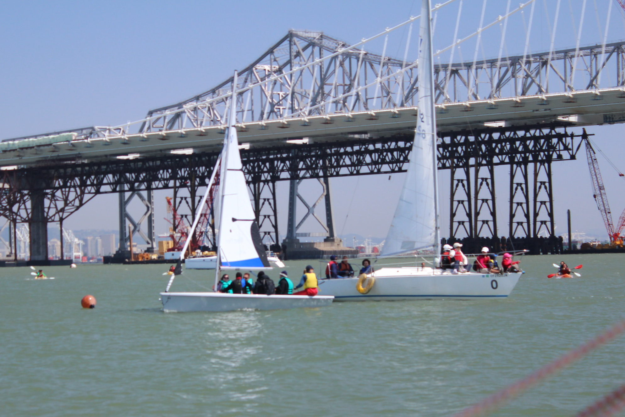 RS Venture and J24 framed by Bay Bridge