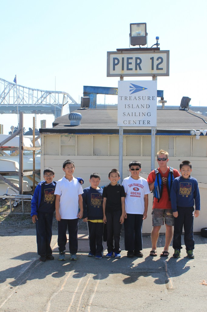 Phil's crew at Treasure Island Sailing Center on the way to check out life jackets - a mandatory accessory on the docks and of course in the boats.