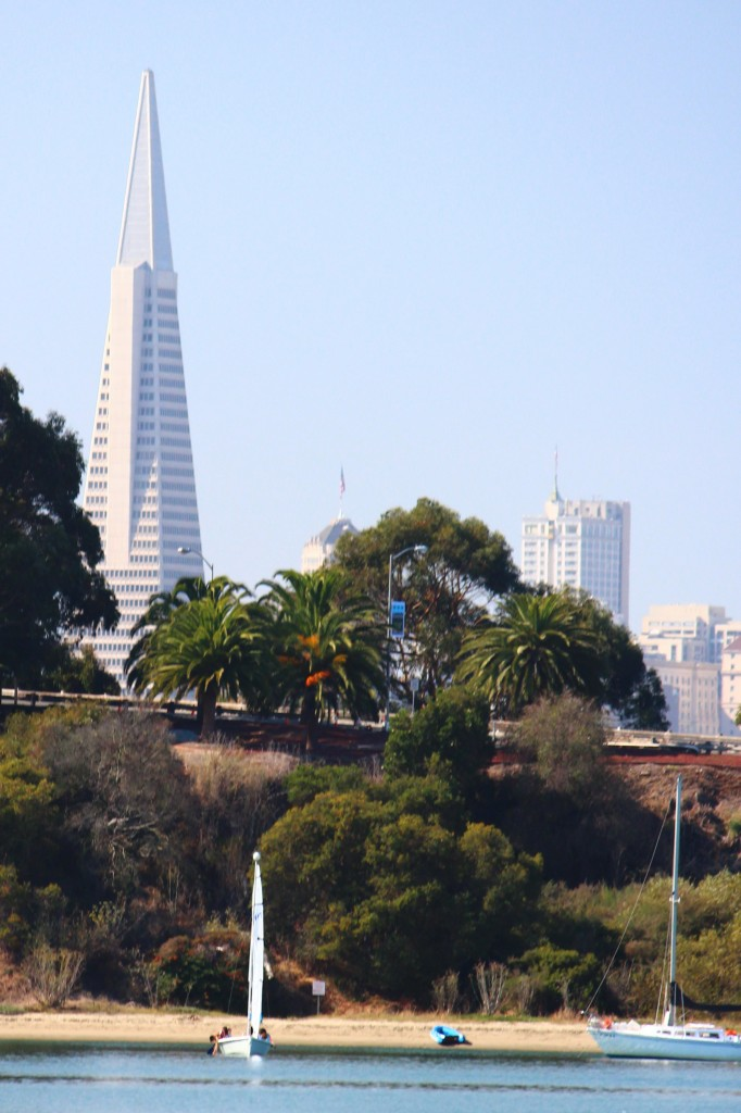 An SSLearn RS Venture framed by the western end of Clipper Cove wtih San Francisco in the background.
