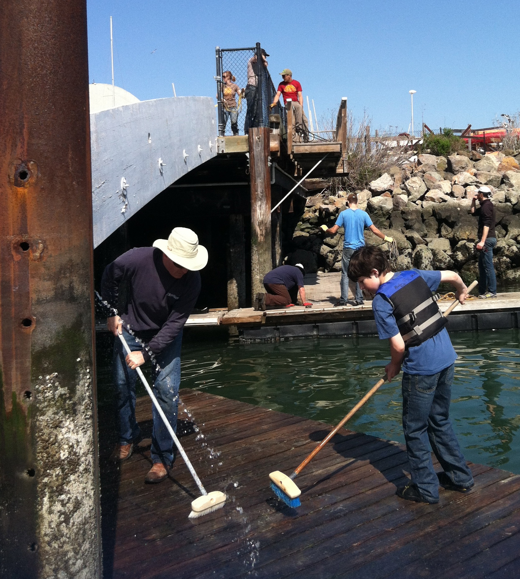 tisc teaches life lessons like teamwork for example onclippercove dockinstall team teamwork lowering dock section dock cleaning team