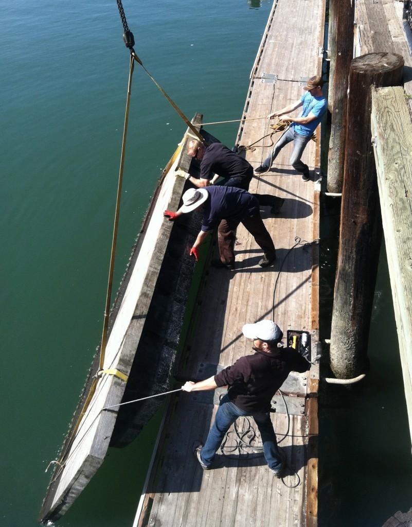 Teamwork lowering dock section