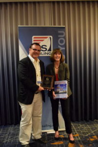 Travis Lund with Trice Kilroy Receiving USS Award