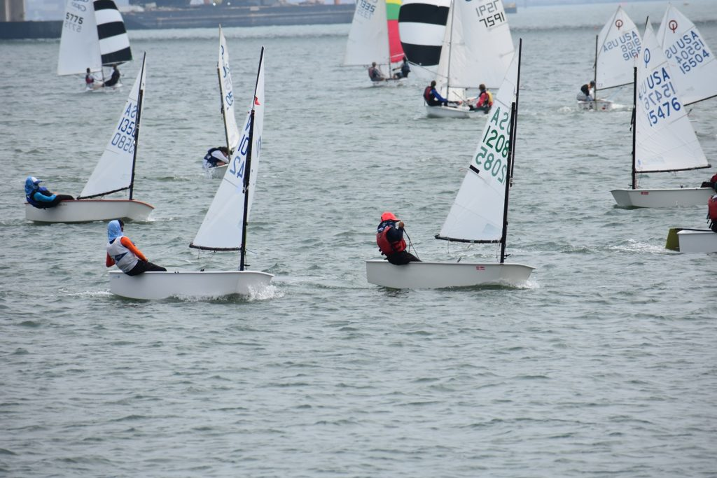 The determined Opti racers make their way to the windward mark.