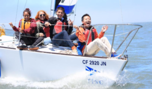 kids smiling on j24 bow